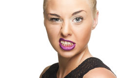 Hübsche Frau in Violet Lips Showing Wacky Face Stockbild
