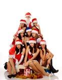 Hübsche Frauen und Weihnachtsmann Lizenzfreie Stockfotografie