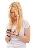 Hübsche Jugendliche Texting Stockfoto