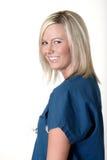 Hübsche Krankenschwester mit freundlichem Ausdruck Lizenzfreie Stockfotografie