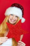 Hübsche lächelnde Frau mit rotem Stern Stockfoto