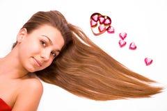 Hübsche Mädchen- und Schokoladeninnere Lizenzfreies Stockfoto