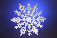 Hübsche Weihnachtsschneeflocke Lizenzfreie Stockfotos