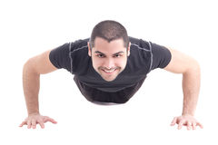 Hübscher bärtiger arabischer Mann, beim Sportkleidungshandeln drücken oben lokalisiert Stockbilder