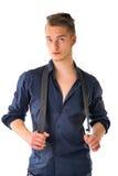 Hübscher blonder junger Mann auf weißem Hintergrund Stockbilder