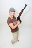 Hübscher Brunette mit Gewehr Stockfotos