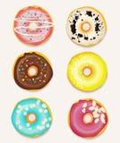 Hübscher Gebäckhintergrund mit Schokolade, Rosa und Banane färben glace Schaumgummiringe Stockfotos