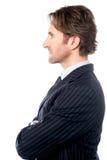 Hübscher Geschäftsfachmann, Seitenhaltung Lizenzfreies Stockbild