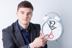 Hübscher Geschäftsmann Advertising Alarm Clock Lizenzfreie Stockbilder