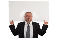 Hübscher Geschäftsmann, der Ihr Produkt darstellt Stockfoto