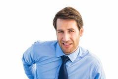 Hübscher Geschäftsmann mit Rückenschmerzenstellung Stockfotos