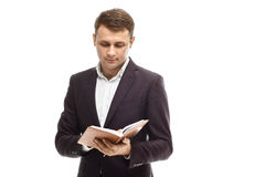 Hübscher Geschäftsmann mit Tagebuch Lizenzfreie Stockfotografie