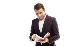 Hübscher Geschäftsmann mit Tagebuch Lizenzfreies Stockbild