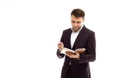 Hübscher Geschäftsmann mit Tagebuch Stockfotos