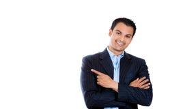 Hübscher Geschäftsmann oder Rechtsanwalt oder Politiker, die auf Kopienraum auf links zeigen lizenzfreie stockbilder