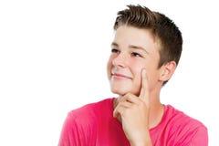 Hübscher jugendlich Junge, der beiseite lokalisiert schaut Stockfoto