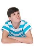Hübscher Jugendlichjunge stellt sich vor Stockfotografie