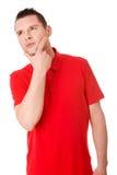 Hübscher junger durchdachter Mann stockfoto