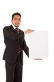 Hübscher junger Mann, der ein leeres Brett hält Lizenzfreies Stockfoto