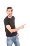 Hübscher Kerl, der auf die Seite zeigt Lizenzfreies Stockbild