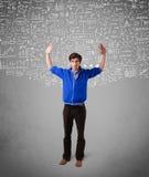 hübscher Kerl mit Hand gezeichneten weißen Berechnungen und Ikonen Stockbilder