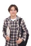 Hübscher lächelnder Jugendlicher mit Taschensatz und -büchern Stockfoto