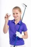 Hübscher Mädchengolfspieler auf weißem backgroud im Studio Lizenzfreie Stockfotos