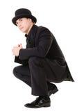 Retro stilvoller Mann im schwarzen Anzug lizenzfreie stockfotografie