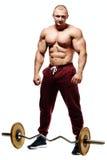Hübscher muskulöser Bodybuilder, der für Eignungstraining sich vorbereitet Lizenzfreie Stockbilder
