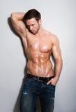 Hübscher sexy junger Mann Stockfoto