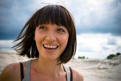 Hübsches Frauenlächeln Stockfotos