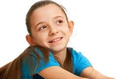 Hübsches lächelndes Mädchen im Blau Stockbild