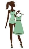 Hübsches Mädchen, das angekleidet erhält Stockbilder