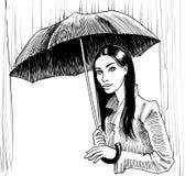 Hübsches Mädchen im Regen Stockfoto