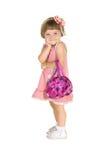 Hübsches Mädchen im rosa Kleid mit Handtasche Stockbilder