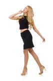 Hübsches Mädchen im schwarzen Minikleid lokalisiert auf Weiß Stockbilder