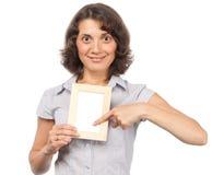 Hübsches Mädchen mit einem Fotofeld Lizenzfreies Stockbild