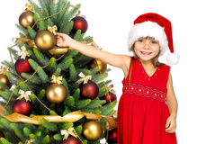 Hübsches Mädchen mit Geschenk nahe dem Cristmas-Baum Lizenzfreies Stockbild