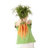 Hübsches Mädchen mit reifen Karotten Lizenzfreie Stockfotografie