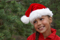 Hübsches Mädchen Sankt im Hut lizenzfreies stockbild