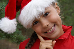 Hübsches Mädchen Sankt im Hut Lizenzfreies Stockfoto