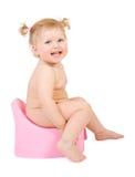 Hübsches Schätzchen und rosafarbenes potty Lizenzfreie Stockfotos