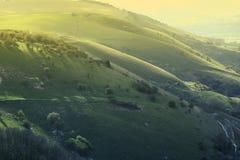 Hügel bei Sonnenuntergang Stockbild