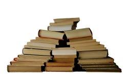 Hügel von den alten Büchern lokalisiert auf weißem Hintergrund Stockbild