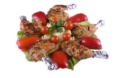 Hühnerbeine und Gemüse Stockfoto