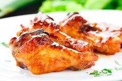 Hühnerflügel mit Honigsoße Stockfotografie