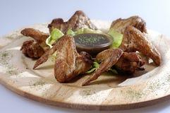 Hühnerflügel mit Soße Lizenzfreie Stockfotografie