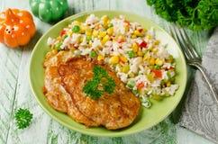 Hühnerhiebe mit Reis und Gemüse Lizenzfreie Stockfotografie