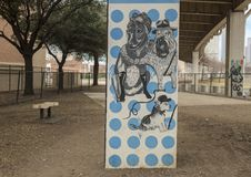 Hündchen-themenorientierte Kunst im Barken-Park zentral, tiefes Ellum, Texas lizenzfreie stockbilder