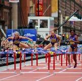 Hürden-große Stadt-Spiele Manchester 2015 das 100m der Frauen Stockbild